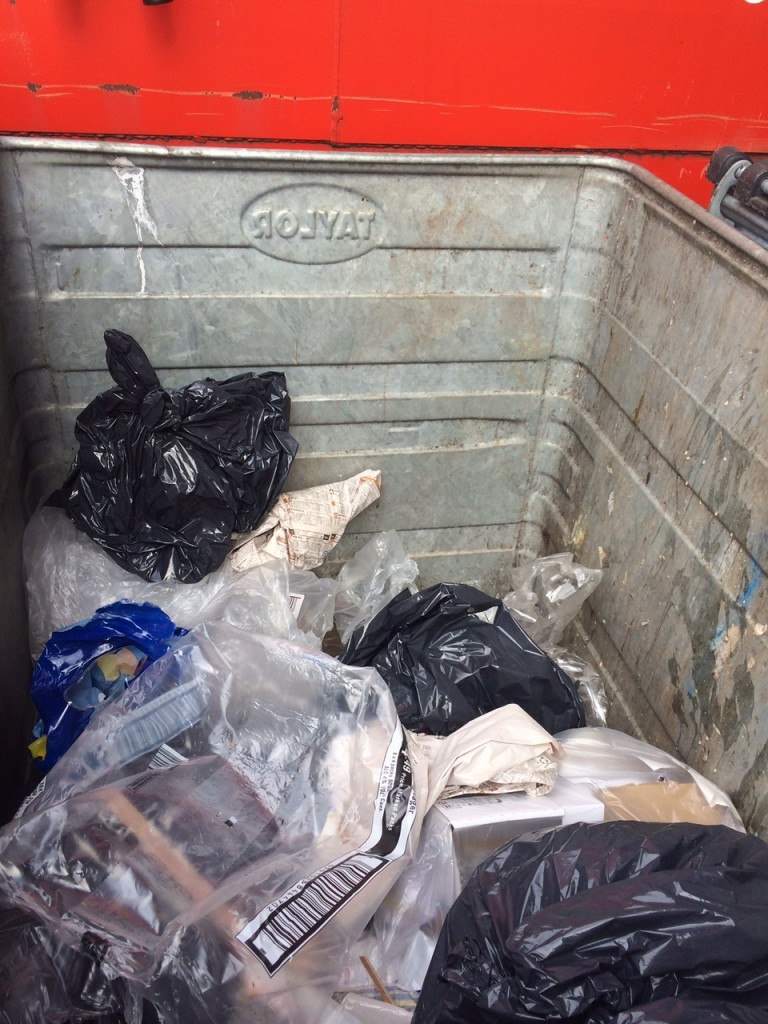 This is the client's bin AFTER we emptied the cardboard on the top: there is still more cardboard in there. This could all be recycled and the general waste disposal costs slashed.